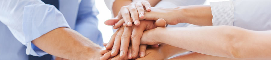 Why Credit Unions are Better - Image of people piling their hands on top of one another